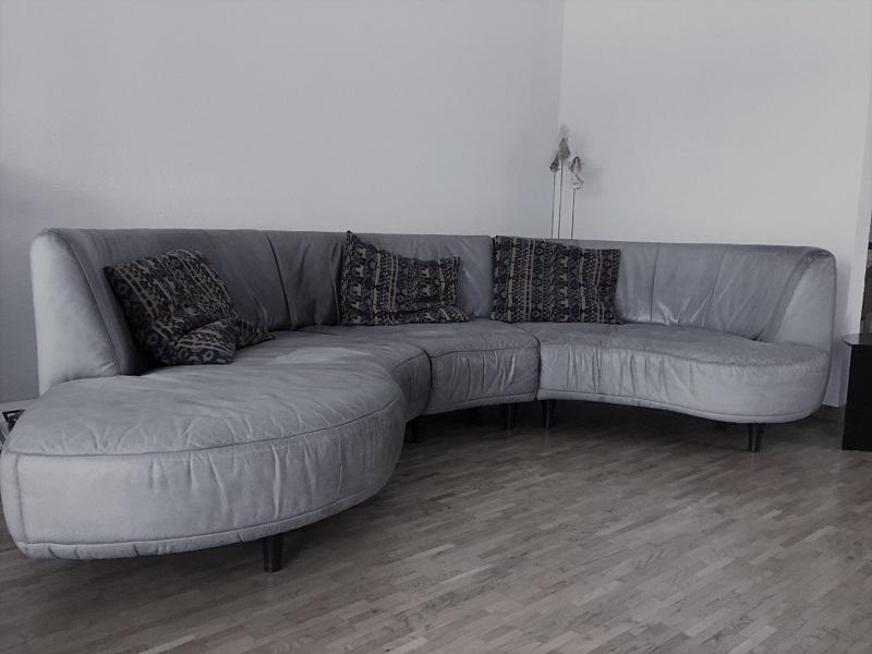 Geschwungenes Sofa neu beziehen - Interio